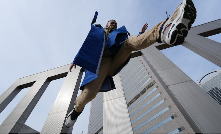 Image of a person jumping from a very close angle to the ground