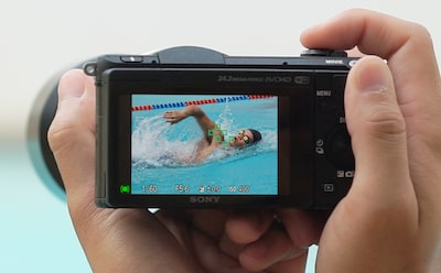 camera screen man swimming